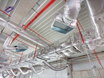 Ceiling under construction. Network of hvac and fire fighting system on the future store ceiling