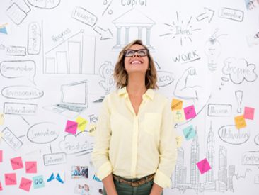 Creative business woman thinking and brainstorming with a wall chart at the background