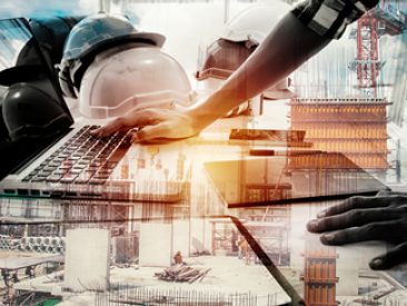 Double exposure architect working with laptop and blueprints in workplace for architectural plan,selective focus,Business concept